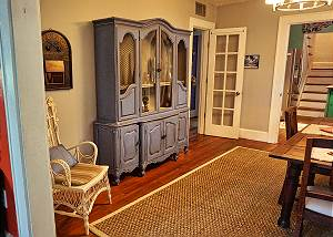In the dining area to the back left of the Hutch is another doorway that leads to the bath and two downstairs bedrooms