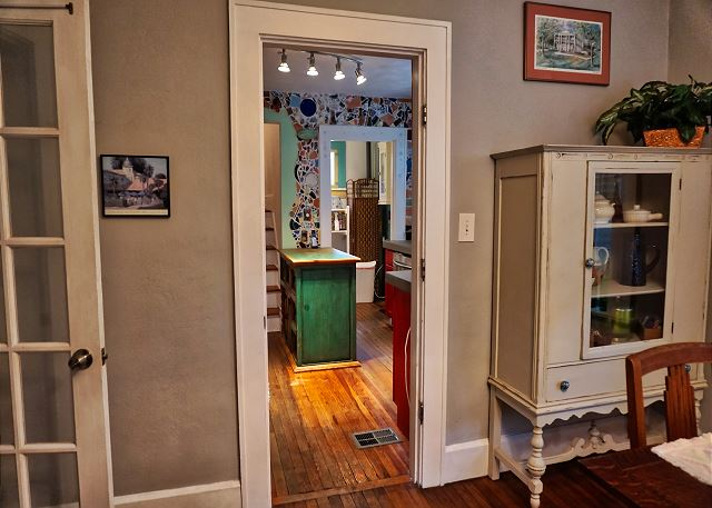 The kitchen entry door viewing from the dining area which is off of the living room