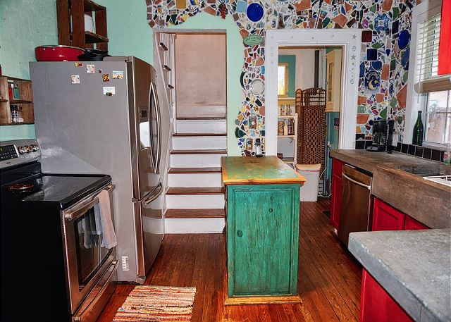 From the doorway through the kitchen is the stairway leading upstairs.