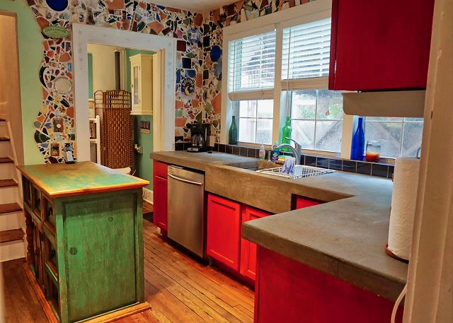 As you enter this one of a kind artistic kitchen you will be enthralled by the hand work mosaic and concrete contertops