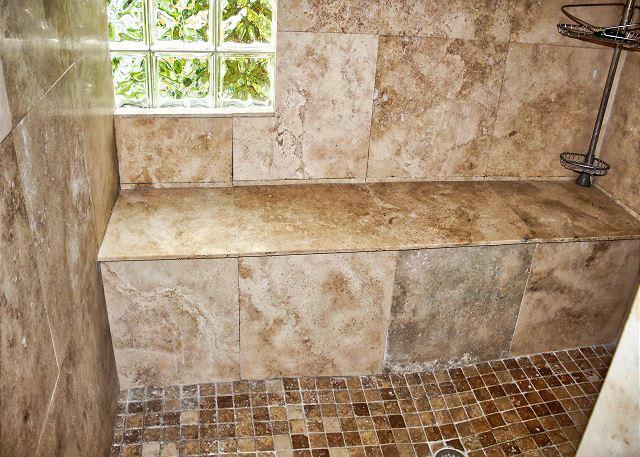 The full length tiled bench in the shower