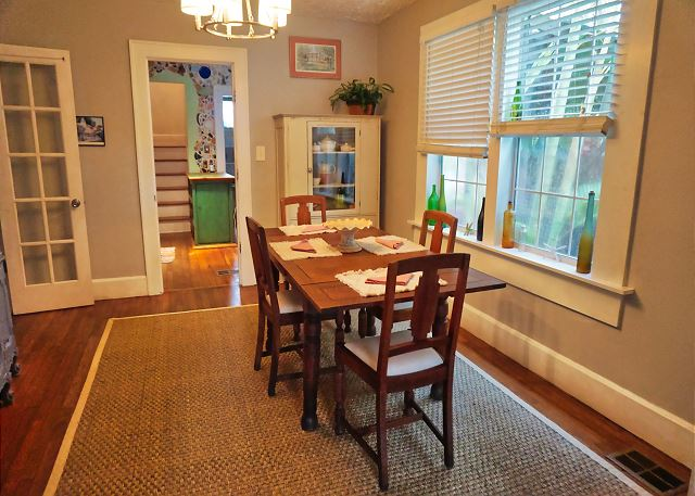 As you walk through the living room the dining area is directly in between there and the kitchen entry
