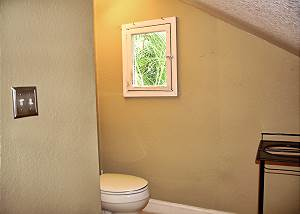 Around from the alcove chair with it's own window is the restroom facility.