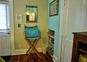 This cozy corner is next to the closet and the shelving unit of the guest room.