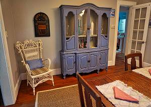 This tasteful blue toned hutch is a piece of art in itself in the dining area.