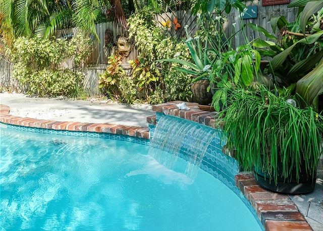 The Pool fountain adds an ambiance of streaming water sounds around the tropical garden