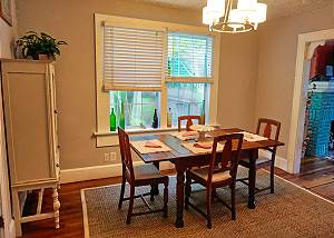 View of the dining with windows while standing next to the Hutch