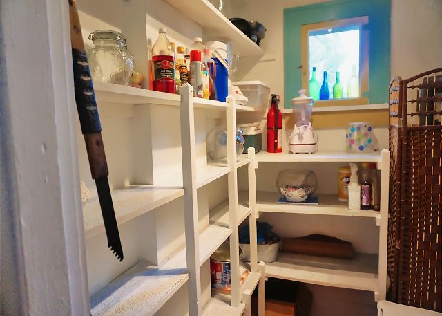 The spacious pantry offers plenty of room for more stock and offers more items you may use during your vacation stay.
