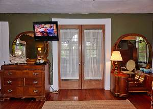 As you enter the Master Bedroom you will see a set of double doors straight ahead, the twin beds are in this closed off area.