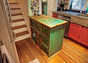 The island in the kitchen also offers storage from both sides below it's counter top