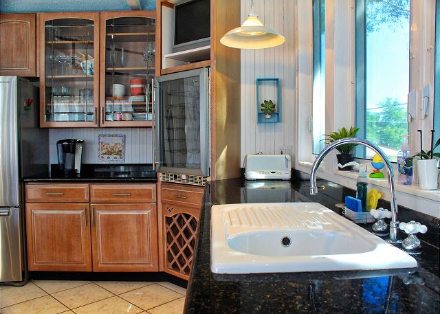 Double sinks, spacious counter and an outdoor view