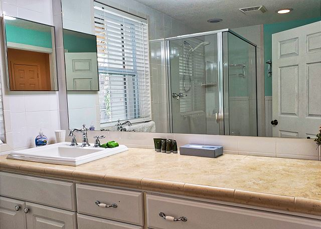 The lower level vanity offers plenty of cabinet storage