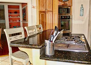 Sitting counter behind the cook stove is island style