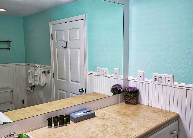 Plenty of vanity space and a large viewing mirror in the lower bath