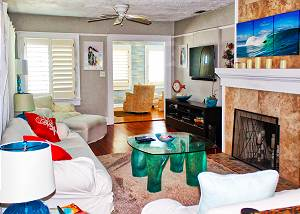View as you enter the upstairs living area which has a fireplace and cushy comfort seating for a nice size group.
