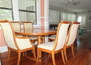 View of the dining area from the kitchen entry looking towards the living room