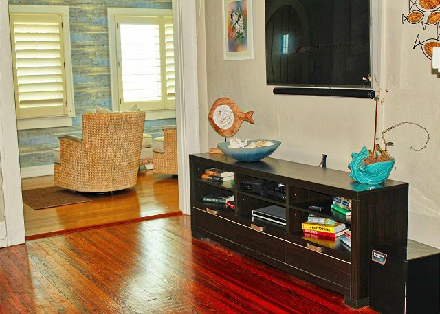 View from the upper level couch, Flat screen TV and the entry to the front sitting area that offers a gorgeous Gulf View