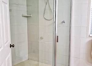 The lower level offers a spacious standup shower