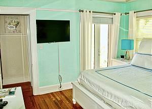 A flat screen TV and warming wood floors