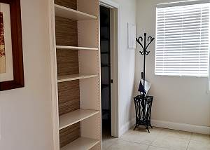 When you enter the home, to the immediate right there is a hall with a bookcase, the immense storage room is just past on the left