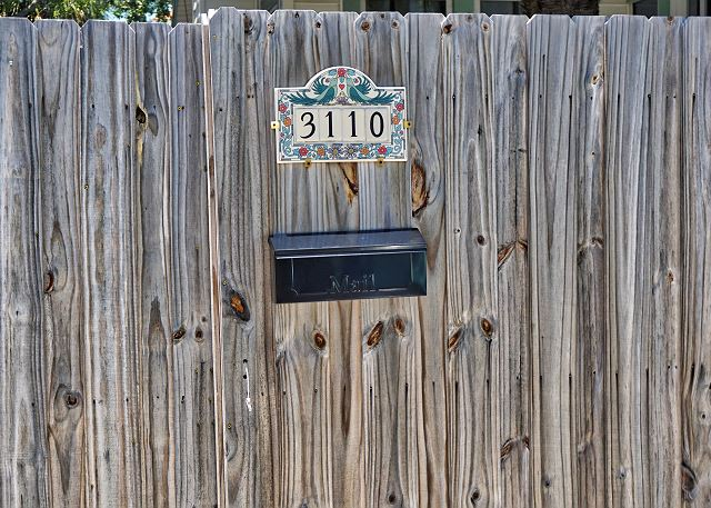 The front gate where the parking is located is right on Pass-A-Grille Way. The address is attached to the Gate at a visual height with the mailbox