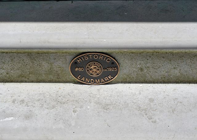 Attached to the entry steps from the city marking the home as an Historical Landmark, Built in 1925