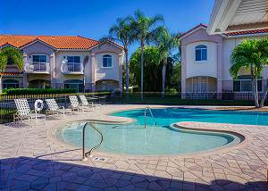 The community pool around the corner, this end offers a shallow play or sitting area to keep cool.