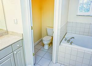 There is a privacy pocket door for the restroom which is located between the tub and vanity.