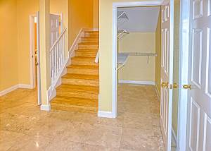 Your view from the foyer as you enter, to the right is the garage door entry. The downstairs has a huge walk in storage closet, stairs to the upper level and a half bath to the left of the stairway.