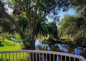 The Master Bedroom has a private balcony with views of the pond and sections of the golf course.
