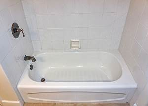 The upstairs Guest Bath offers a soaking tub and shower.