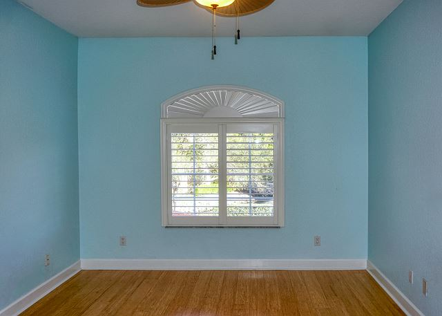 Standing at the spacious walk-in closet looking to he front window in the second guest bedroom.