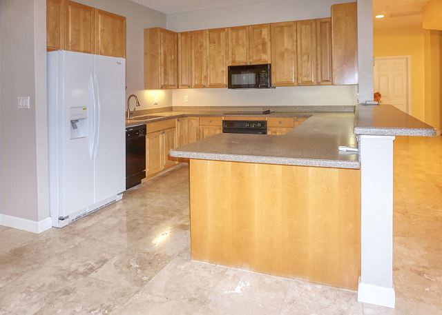 The kitchen wraps around and easily accessible from the dining and living area.
