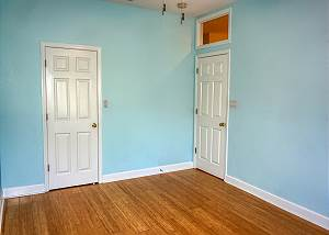 From the window corner in the second guest bedroom, the closet to the left and the entry door is to the right.