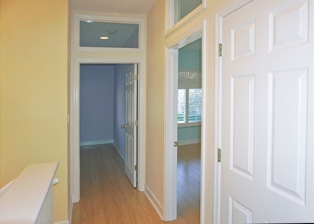 As you reach the top of the stairs to the left are the guest bedroom entries.