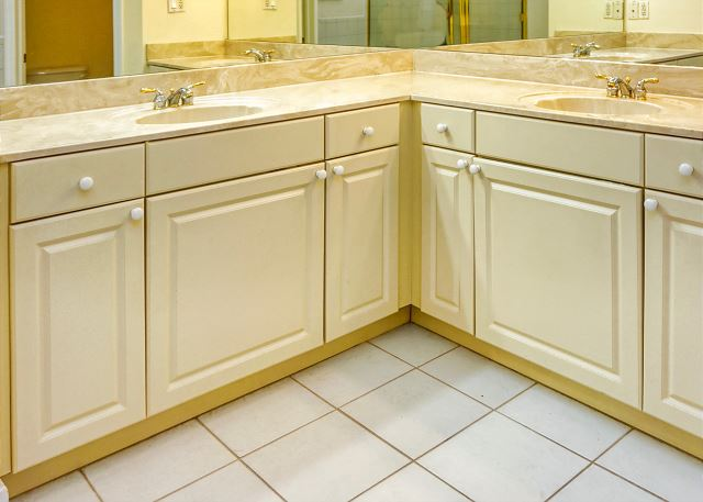 Wrap around cabinets, double sinks and counter space in the Master bath