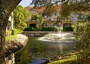 View of the fountain and pond across the street from your entry.