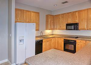 Dishwasher, Stove, Microwave, Refrigerator and plenty of storage space above and below for your dish ware.