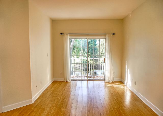 As you enter the Master bedroom with its spacious floor space and double walk in closets. Your view of the private balcony looking out over the pond, golf course and foliage offers a tranquil atmosphere.