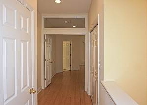 The top of the stairs to your right, this is the view of the Master Entry, to the right are the doors to the laundry, to the left the guest bedrooms bath.