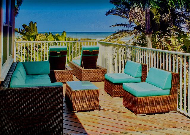 The North side Balcony offers cushioned seating, 2 lounge chairs in front facing the Gulf, along with entry from both bedrooms through a private door.