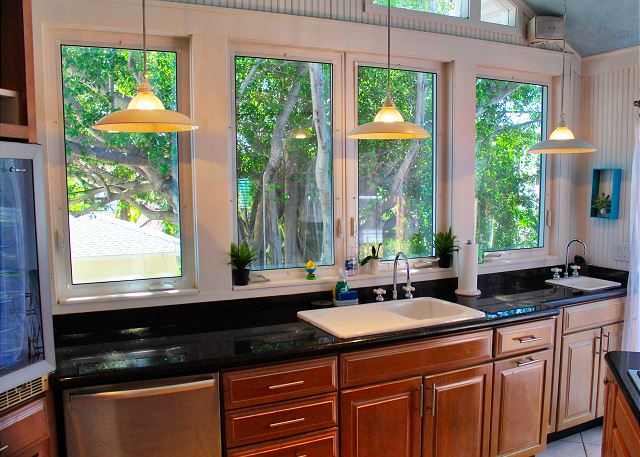 Views of greenery surround the spacious kitchen and open glass windows