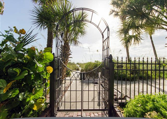 Through the back patio gate and down the sandy path to a private serene shoreline.