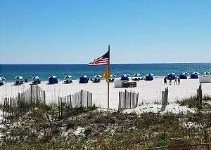 Beach in front of complex-Descriptive