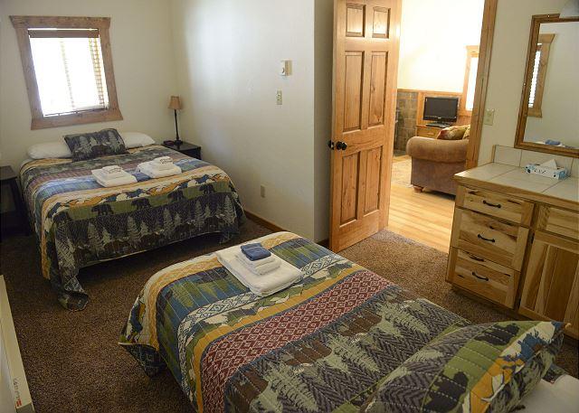 Bedroom 2 w/ queen and single, sink & vanity