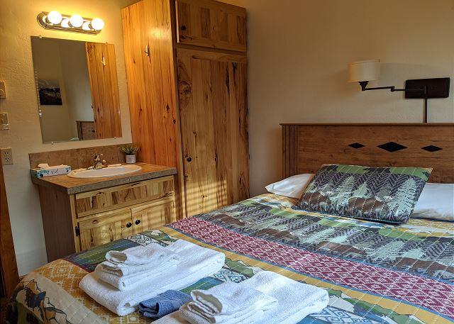 Queen size bed, sink & vanity