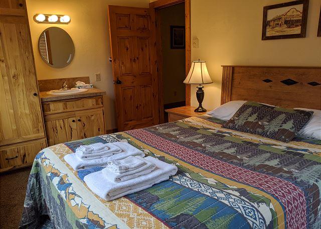 Another queen size bed, sink & vanity