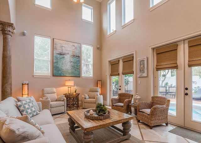 First Floor: Living Room Opens up to Private Pool