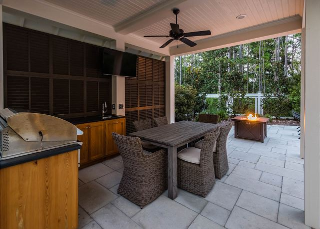 Outdoor Kitchen and Living Area with Fire Pit