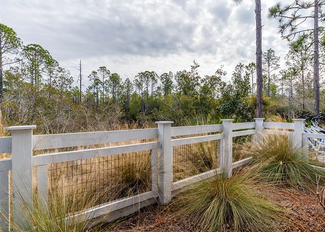 Fenced Backyard of Home overlooking Pond and Forest